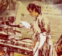 A picture of Mary Katherine Goddard at the printing press