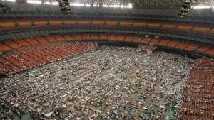 A lot of people being housed in a stadium after Hurricane Katrina disaster