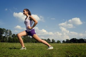 Woman doing lunges outside