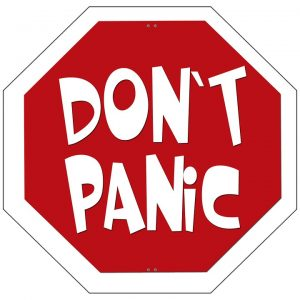 An octagon sign that says 'Don't Panic'