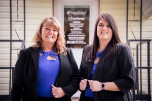 Linda Rawson and Jennifer Remund in front of the DynaGrace office